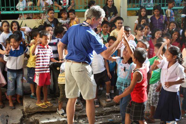 Doug with kids school